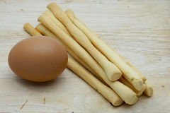 Close up of boiled egg and grissini. Close up of bolied egg and grissini on wooden background Stock Photo