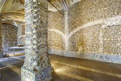 Chapel of Bones in Royal Church of St. Francis, Evora, Alentejo, Portugal. Close-up of a bone-laid pillar and wall, Chapel of Bones in Royal Church of St royalty free stock image