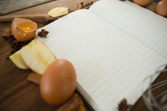 Close up of book with apple and egg Royalty Free Stock Photos
