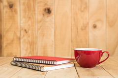 Close up book and coffee cup on wooden table Stock Images