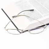 Close up of the book with glasses Royalty Free Stock Photography