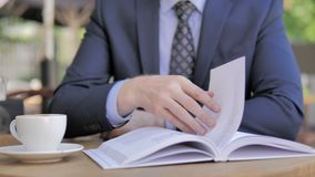 Close Up of Book, Reading Businessman stock footage