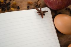 Close up of book with spice and egg Royalty Free Stock Image