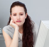 Close-up of a bored young businesswoman Royalty Free Stock Image