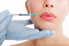 Close up botox shot in the female lips Stock Images