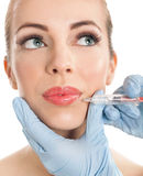 Close up botox shot in the female lips Stock Photography