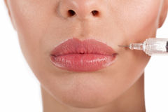 Close up botox shot in the female lips,isolated Royalty Free Stock Image