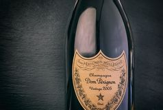 Close-up of Bottle of Champagne Dom Perignon Vintage 2005 against black background. Tambov, Russian Federation - August 14, 2018 Close-up of Bottle of Champagne royalty free stock photo
