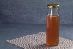 Bottle of date fruit juice. Close up bottle of date fruit juice stock photo