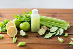 Close up of bottle with green juice and vegetables Royalty Free Stock Image