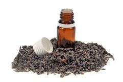 Bottle of lavender essential oil on a white background royalty free stock photos