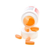 Close-up bottle of yellow pills on white Royalty Free Stock Photos