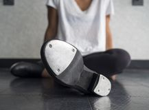 Tap dancer relaxing in dance class stock image