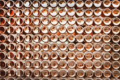 Bottoms of brown beer bottles group patterns texture on wall abstract for background royalty free stock photos