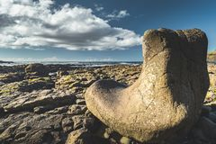 Close-up boulder on stone beach. Sky background. royalty free stock images