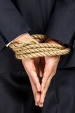 Close up of bound hands of businessman Royalty Free Stock Photo