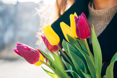 Close-up of a bouquet of flowers in a female hand outdoors stock images