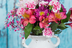 Close up of a bouquet of flowers in a vintage white vase Stock Photography