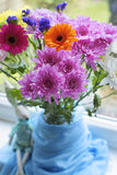 Close up of  bouquet  in vase on the window seat. Close up of  spring colorful bouquet  in vase on the window seat Royalty Free Stock Images