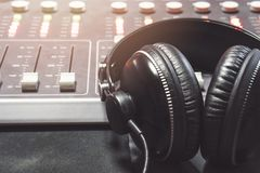 Close-up of boutique recording studio control desk. And headphone royalty free stock photo