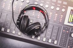 Close-up of boutique recording studio control desk. And headphones stock photo