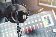 Close-up of boutique recording studio control desk. Close-up of boutique recording studio control desk and headphone royalty free stock photo