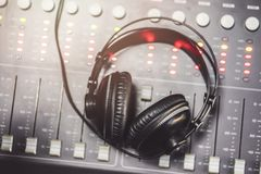 Close-up of boutique recording studio control desk. And headphones stock photography
