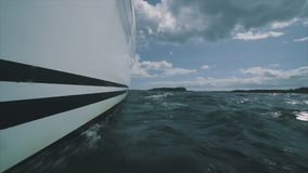 Close up on the bow of a sailing yacht. Breaking through a wave stock footage