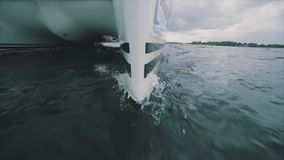 Close up on the bow of a sailing yacht. Breaking through a wave stock video footage
