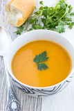 Close up of a bowl of carrot, pumkin and sweet potato soup Stock Photography