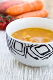 Close up of a bowl of carrot, pumkin and sweet potato soup Stock Photo