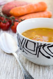 Close up of a bowl of carrot, pumkin and sweet potato soup Royalty Free Stock Photos