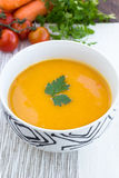 Close up of a bowl of carrot, pumkin and sweet potato soup Stock Image