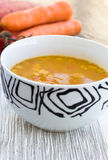 Close up of a bowl of carrot, pumkin and sweet potato soup Royalty Free Stock Image