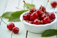Close up of a bowl of delicious ripe red cherries royalty free stock images