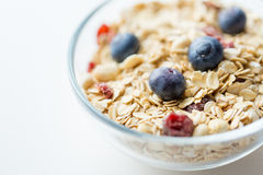 Close up of bowl with granola or muesli on table Stock Photos