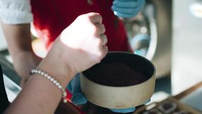 Close - up of a bowl of ground cocoa. Chocolatier tells the recipe of chocolate visitors stock video footage