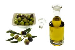 Close up of a bowl of olives and extra virgin olive oil in a gla Royalty Free Stock Images