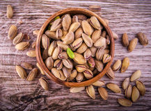 Close up of a bowl of pistachio nuts wood background. Pistachio nuts  Concept and Decoration Royalty Free Stock Image