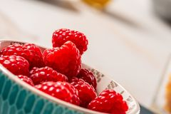 Close up of bowl of raspberries. A close up of bowl of raspberries Royalty Free Stock Photo