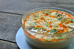 Bowl of spicy Thai Tom Yum soup Stock Photos