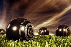 Close up of bowling balls at sunset