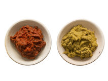 Indian red and yellow curry paste Royalty Free Stock Photos