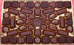 Close-up box of chocolates. Close-up red box of chocolates Royalty Free Stock Images