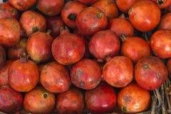 Close-up of box with many Italian pomegranates in fair royalty free stock image