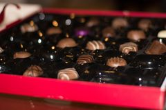 Close up box of milk chocolates with shallow depth of field royalty free stock photo