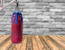 Close up Boxing bags at wooden floor with blurred brick wall bac Stock Photography