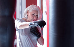Close up of boxing elderly lady Stock Images