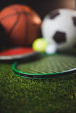 Close up of boxing gloves and basketball football tennis golf balls and discus Stock Image