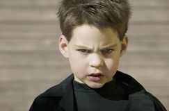 Close Up of a Boy with Attitude. Cloce-up of a young boy with a defiant attitude royalty free stock images